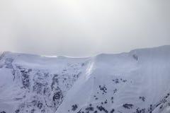 Sunlight off-piste slope in mist Royalty Free Stock Photos