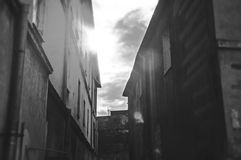 Sunlight between old buildings Royalty Free Stock Photo