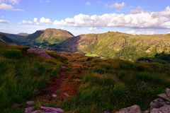 Sunlight over the Angletarn Pikes. The Patterdale Valley from Hartsop above How Royalty Free Stock Photo