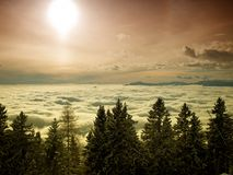 Sun above clouds Stock Photography