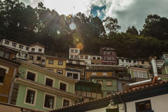 Sunlight over the houses in the hill in Cudillero, Asturias Royalty Free Stock Photography
