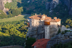 Sunlight over monastery Roussanou in the morning on top of the mountain, Meteora, Greece Royalty Free Stock Photo