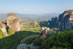 Sunlight over monastery Roussanou in the morning on top of the mountain, Meteora, Greece Stock Photo
