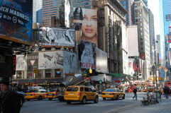 Sunlight penetrates the canyon of Times Square Royalty Free Stock Photography