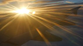 Sunlight rays against wing airplane stock footage