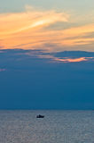Sunlight reflected on clouds after sunset, west coast of Sithonia, Greece Stock Photo