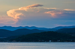 Sunlight reflected on clouds after sunset, west coast of Sithonia, Greece Stock Photography