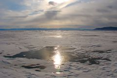 Sunlight reflected on dark ice on a lovely winter day royalty free stock images