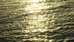 Sunlight reflected off dark water stock footage
