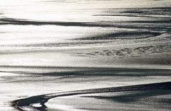 Sunlight reflecting off wet sand and water Stock Photo