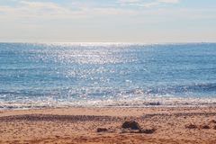 Sunlight reflecting on sparkling blue sea at Southwold beach in UK stock photos