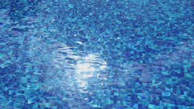 Sunlight reflection in blue water, pool surface ripple, vacation. Stock footage stock footage