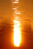 Sunlight reflection on water Stock Images
