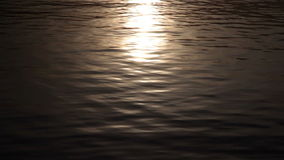 Sunlight reflections on water surface stock video