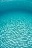 Sunlight Ripples Across Sand Underwater Stock Photo