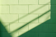 Sunlight and shadows on the wall of the building. Royalty Free Stock Images
