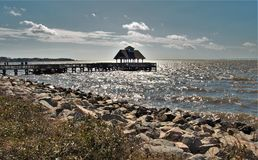Sunlight Shimmering on Waters of Pamlico Sound. The Pamlico Sound is the largest sound on the East Coast. The sound is fed by three different inlets, Oregon Royalty Free Stock Images