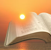 Sunlight shine through bible pages Royalty Free Stock Image