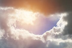 Sunlight shines through the clouds. Toned Royalty Free Stock Photography