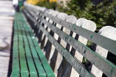 Sunlight shines on empty park bench in Manhattan, New York City Royalty Free Stock Photography