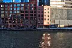 Sunlight shining through building windows reflects pattern onto the Chicago River in the Loop. Sunlight shining through building windows reflects corresponding Royalty Free Stock Photography