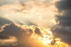 Sunlight shining through the clouds. Royalty Free Stock Image