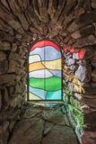 Sunlight shining through colored glass window Stock Image