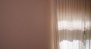 Sunlight shining through curtains and blank wall Royalty Free Stock Photography