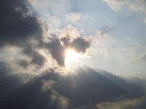 Sunlight shining past cloudy Royalty Free Stock Photo