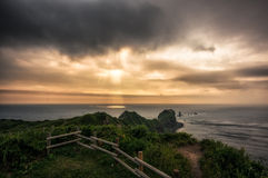 Sunlight shining through the stormy clouds Stock Image