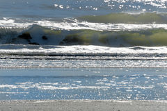 Sunlight shining on the waves. Sunlight shining through breaking waves on a Florida beach Stock Photos