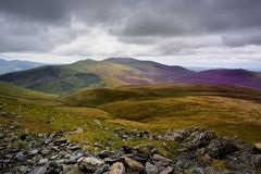 Sunlight on Skiddaw Forest. Dark clouds over Skiddaw Ridge Stock Image