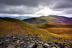 Sunlight on Skiddaw Forest. Dark clouds over Skiddaw Ridge Royalty Free Stock Photos