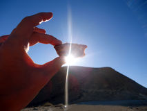Sunlight through a stone in a woman`s hand Royalty Free Stock Photography