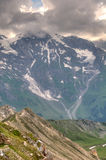 Sunlight through the storm clouds on Glacier Pasterze. Austrian Stock Photo