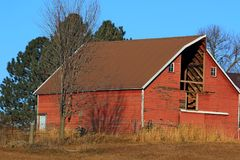 Red Barn with hay loft door missing royalty free stock image