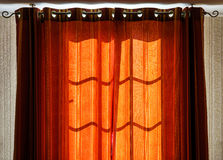 Sunlight through the sunblinds early morning Royalty Free Stock Image