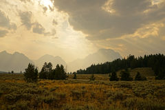 Sun Rays through Clouds. Sunset or sunrise with a haze in the sky at Yellowstone National Park. Rays and clouds. Mountain landscape Royalty Free Stock Images