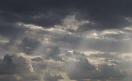 Sunlight throught dark cloud. Sunlight throught dark rainy cloud Royalty Free Stock Photography