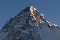 Sunlight on top of K2 mountain peak in a morning, K2 trek, Pakis Stock Image