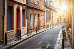 Sunlight in Toulouse. Warm sunlight on narrow street in old center of Toulouse, France Stock Images