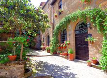 Sunlight Tuscan patio in a Tuscan hill town stock images