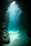 Sunlight and Underwater Grotto. Sunlight pours into an underwater grotto in a remote part of the Solomon Islands. This area is the easternmost part of the Coral Royalty Free Stock Photo