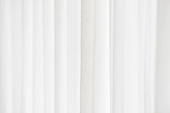 Sunlight through a white curtain. Sunlight enters a room through a white window curtain Stock Images