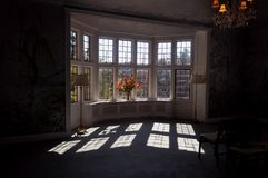 Sunlight through the window. This is a picture taken inside a Victorian living room, where we can see the sunlight through an ample window Royalty Free Stock Photo
