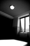 Sunlight Through Window. Sunlight shining through a bare window into an empty corridor with a heater below the window Royalty Free Stock Image