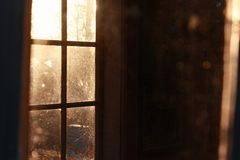 Sunlight through window in a dark room Stock Images
