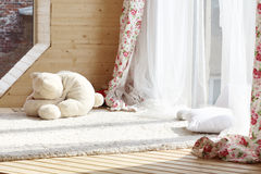 Sunlight from windows with white curtains, fluffy carpet stock images