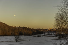 Sunlight in winter landscape with full moon Stock Images