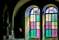 Sunlight Through Yellow Green and Purple Stained Glass Window Royalty Free Stock Photo
